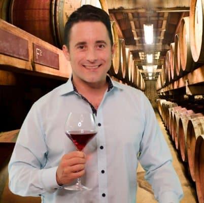 Portrait of Evan holding wine glass