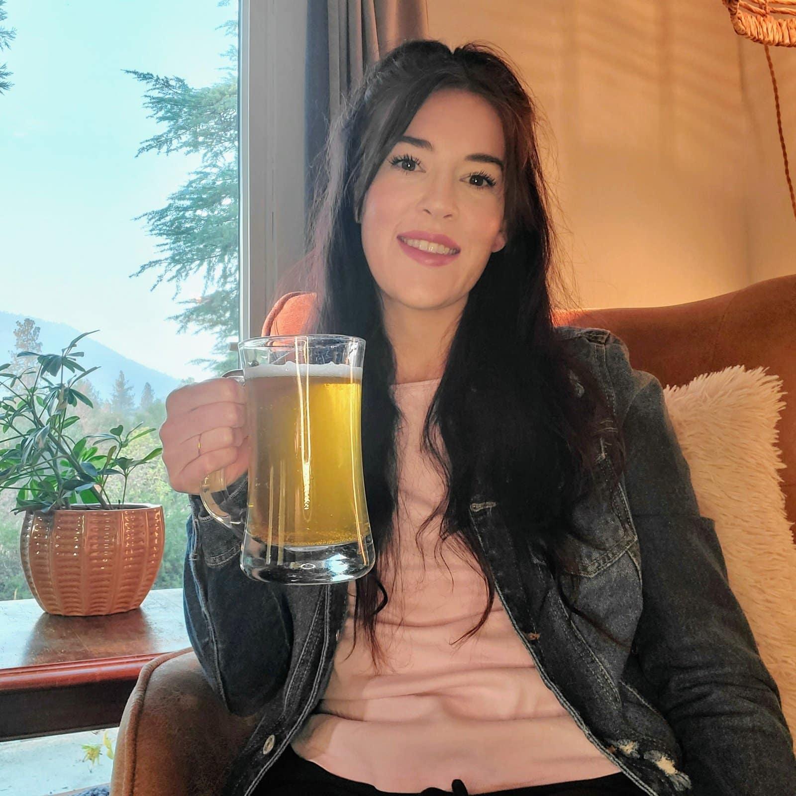 Portrait of Heather holding beer stein