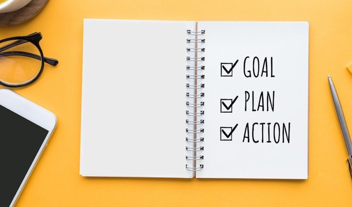 Notebook showing words goal, plan, action